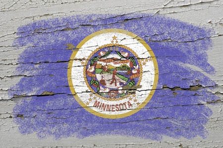 precisely: Chalky american state of minnesota flag precisely painted with color chalk on grunge wooden texture Stock Photo