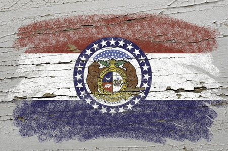 precisely: Chalky american state of missouri flag precisely painted with color chalk on grunge wooden texture