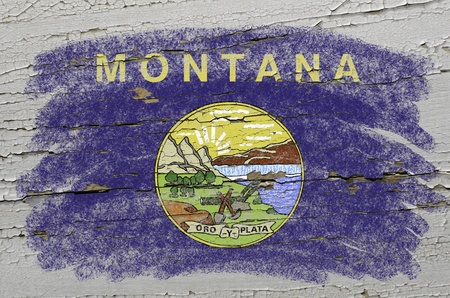 precisely: Chalky american state of montana flag precisely painted with color chalk on grunge wooden texture
