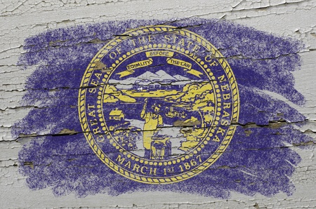 precisely: Chalky american state of nebraska flag precisely painted with color chalk on grunge wooden texture