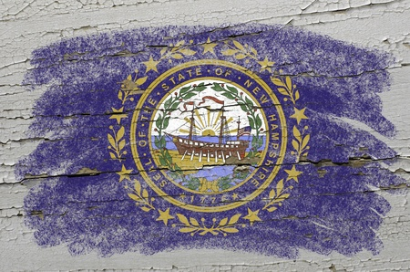 precisely: Chalky american state of new hampshire flag precisely painted with color chalk on grunge wooden texture Stock Photo