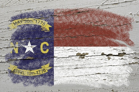 precisely: Chalky american state of north carolina flag precisely painted with color chalk on grunge wooden texture