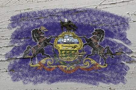 Chalky american state of pennsylvania flag precisely painted with color chalk on grunge wooden texture photo