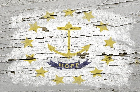 geography: Chalky american state of rhode island flag precisely painted with color chalk on grunge wooden texture Stock Photo
