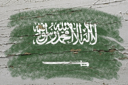 precisely: Chalky saudi arabia flag precisely painted with color chalk on grunge wooden texture