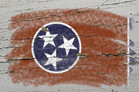Chalky american state of tennessee flag precisely painted with color chalk on grunge wooden texture photo