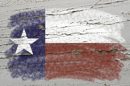 Chalky american state of texas flag precisely painted with color chalk on grunge wooden texture photo
