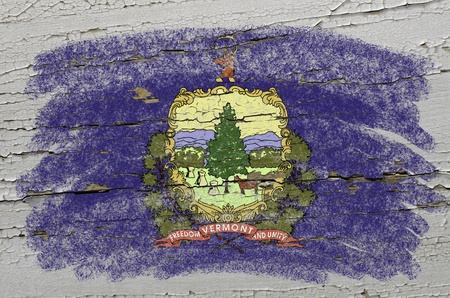 geography: Chalky american state of vermont flag precisely painted with color chalk on grunge wooden texture