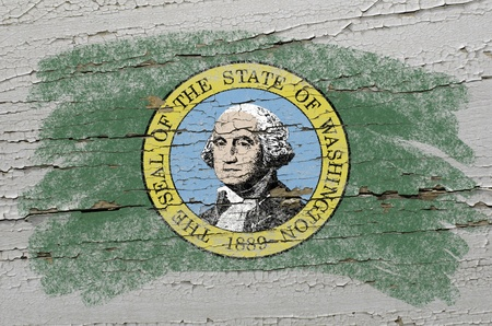 Chalky american state of washington flag painted with color chalk on grunge wooden texture photo