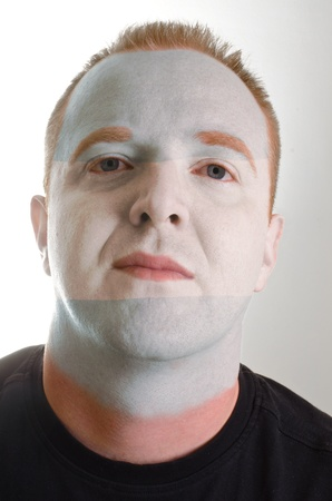 High key portrait of a serious man whose face is painted in national colors of argentina Stock Photo - 12172716