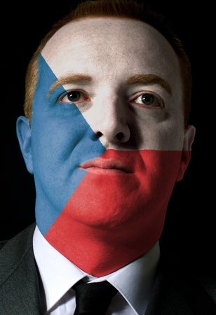 whose: High key portrait of a serious businessman or politician whose face is painted in national colors of czech flag