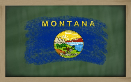 geography: Chalky american state of montana flag painted with color chalk on old blackboard Stock Photo