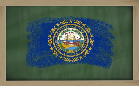geography: Chalky american state of new hampshire flag painted with color chalk on old blackboard