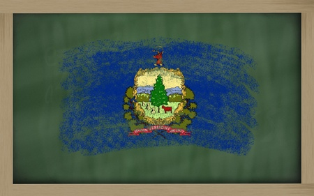 Chalky american state of vermont flag painted with color chalk on old blackboard photo