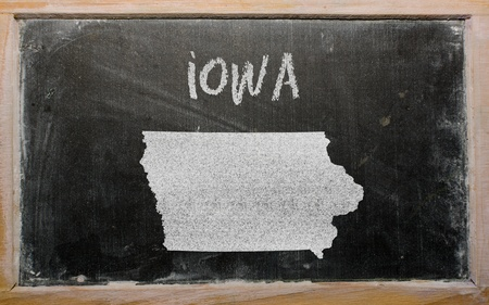 geography: drawing of american state of iowa on chalkboard, drawn by chalk
