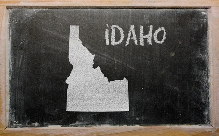 geography: drawing of american state of idaho on chalkboard, drawn by chalk