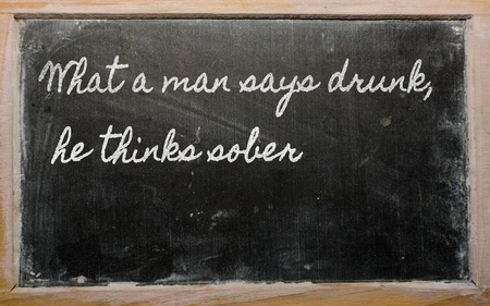 handwriting blackboard writings - What a man says drunk, he thinks sober Reklamní fotografie