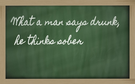 handwriting blackboard writings - What a man says drunk, he thinks sober Stock Photo - 12173095