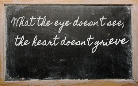 handwriting blackboard writings - Waste not, want not  Фото со стока