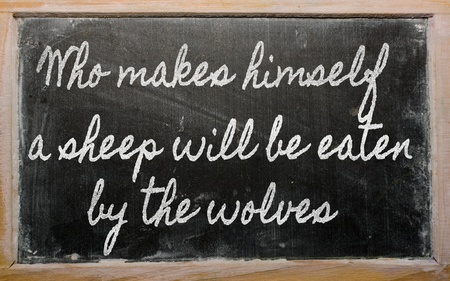 himself: handwriting blackboard writings - Who makes himself a sheep will be eaten by the wolves Stock Photo
