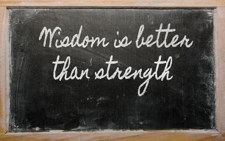 than: handwriting blackboard writings - Wisdom is better than strength