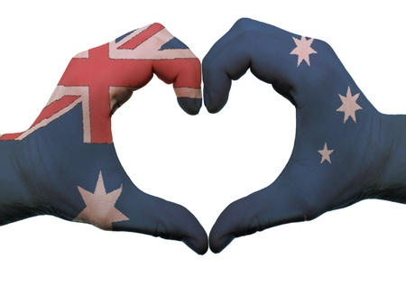 Gesture made by australia flag colored hands showing symbol of heart and love, isolated on white background photo