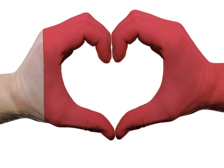 Gesture made by bahrain flag colored hands showing symbol of heart and love, isolated on white background photo