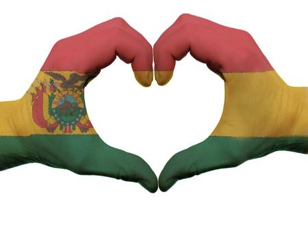 bandera de bolivia: Gesto de las manos la bandera de Bolivia de colores que muestran el s�mbolo del coraz�n y el amor, aislados en fondo blanco
