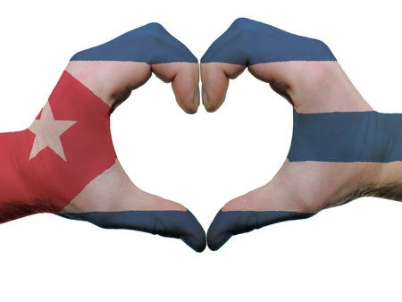 Gesture made by cuba flag colored hands showing symbol of heart and love, isolated on white background Фото со стока