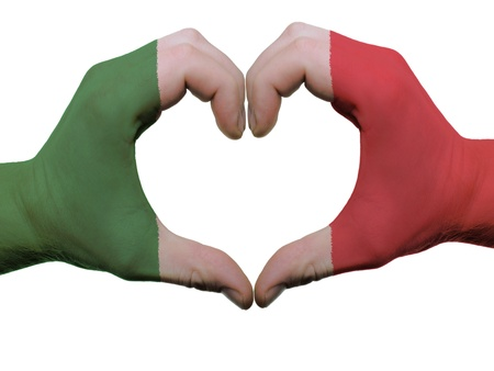 Gesture made by italy flag colored hands showing symbol of heart and love, isolated on white background