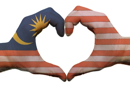 Gesture made by malaysia flag colored hands showing symbol of heart and love, isolated on white background Stock Photo - 12478176