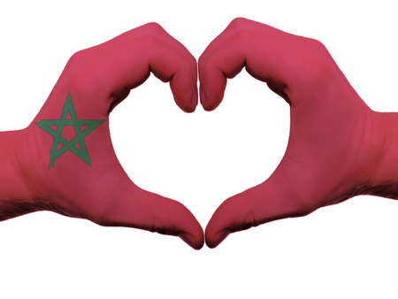 made in morocco: Gesture made by morocco flag colored hands showing symbol of heart and love, isolated on white background