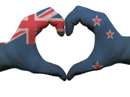 Gesture made by new zealand flag colored hands showing symbol of heart and love, isolated on white background photo