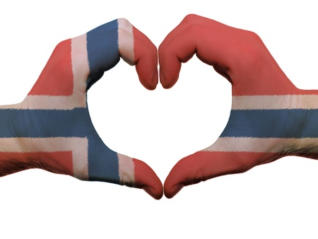 norwegian: Gesture made by norway flag colored hands showing symbol of heart and love, isolated on white background