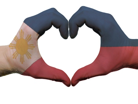 Gesture made by philippines flag colored hands showing symbol of heart and love, isolated on white background