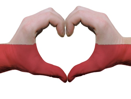 Gesture made by poland flag colored hands showing symbol of heart and love, isolated on white background photo