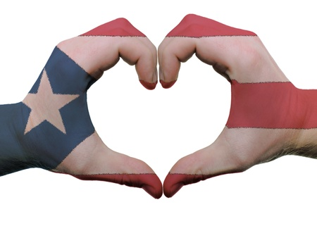 Gesture made by puerto rico flag colored hands showing symbol of heart and love, isolated on white background