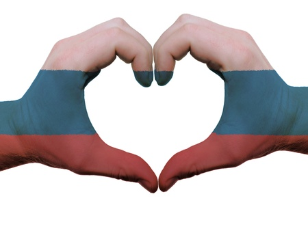 Gesture made by russia flag colored hands showing symbol of heart and love, isolated on white background photo