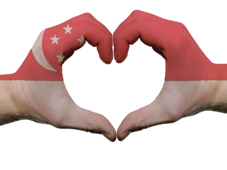 singaporean flag: Gesture made by zimbabwe flag colored hands showing symbol of heart and love, isolated on white background Editorial