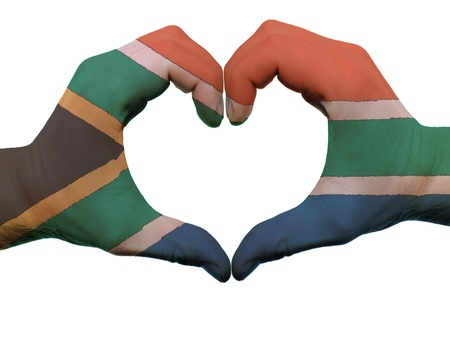 Gesture made by south africa flag colored hands showing symbol of heart and love, isolated on white background
