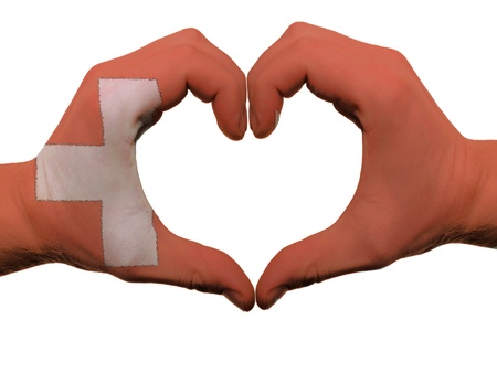 Gesture made by switzerland flag colored hands showing symbol of heart and love, isolated on white background photo