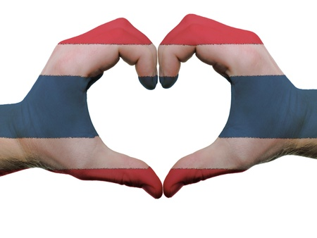Gesture made by thailand flag colored hands showing symbol of heart and love, isolated on white background