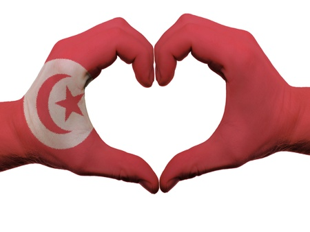 Gesture made by tunisia flag colored hands showing symbol of heart and love, isolated on white background photo