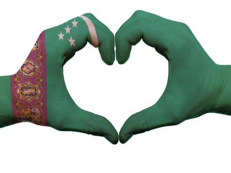 turkmenistan: Gesture made by turkmenistan flag colored hands showing symbol of heart and love, isolated on white background