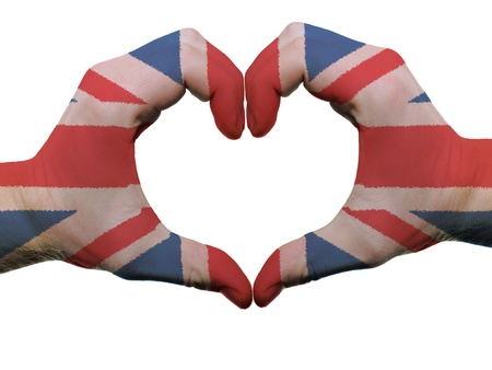 british flag: Gesture made by united kingdom flag colored hands showing symbol of heart and love, isolated on white background Stock Photo