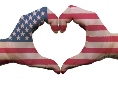 patriotic america: Gesture made by american flag colored hands showing symbol of heart and love, isolated on white background Stock Photo