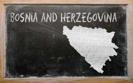 bosnian: drawing of bosnia herzegovina on blackboard, drawn by chalk