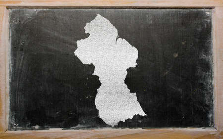 guyanese: drawing of guyana on blackboard, drawn by chalk