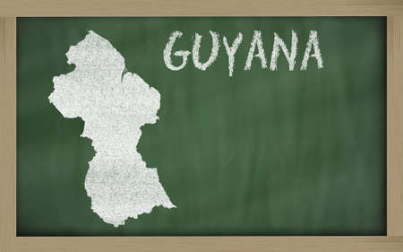 guyanese: drawing of guyana on blackboard, drawn by chalk