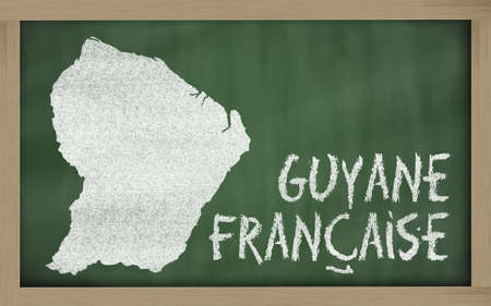 drawing of french guiana on blackboard, drawn by chalk Stock Photo